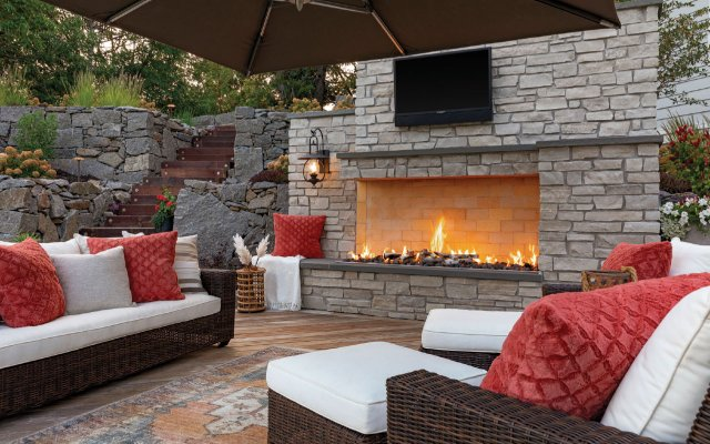 outdoor fireplace with TV on the mantle