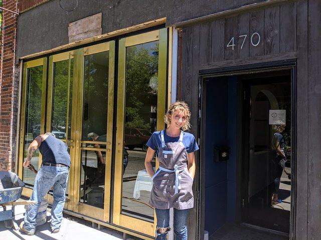 woman standing outside restaurant