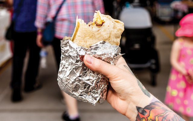 breakfast burrito in hand
