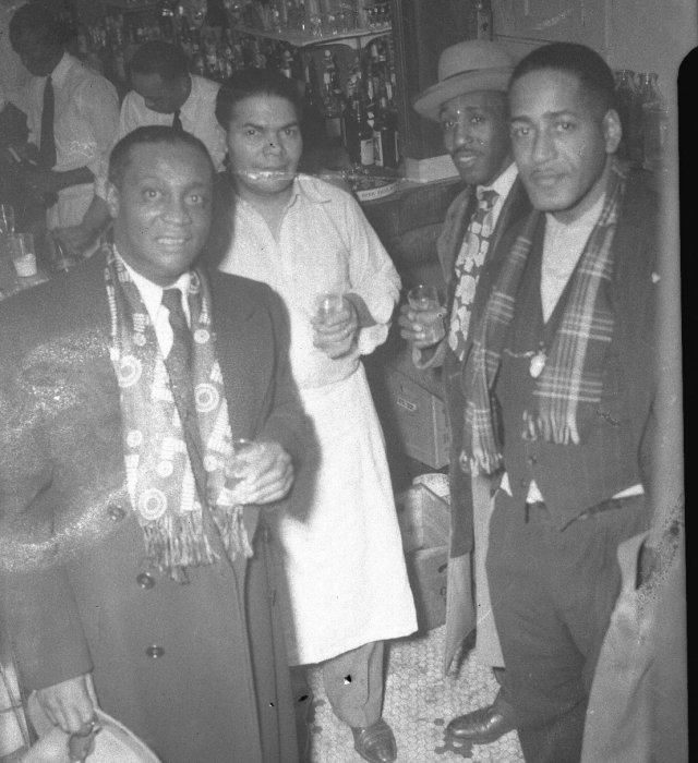 four guys in a bar