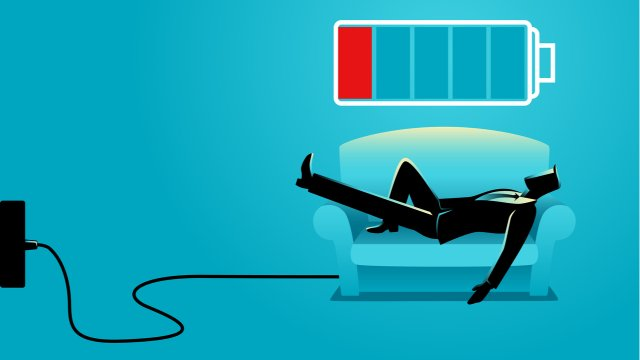 Business man takes nap on sofa to recharge his battery