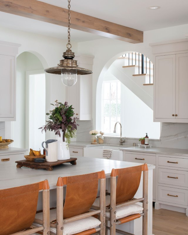 white kitchen with leather backed stools