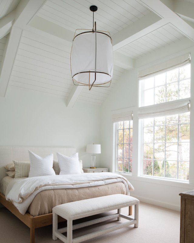 White Bedroom with vaulted ceilings