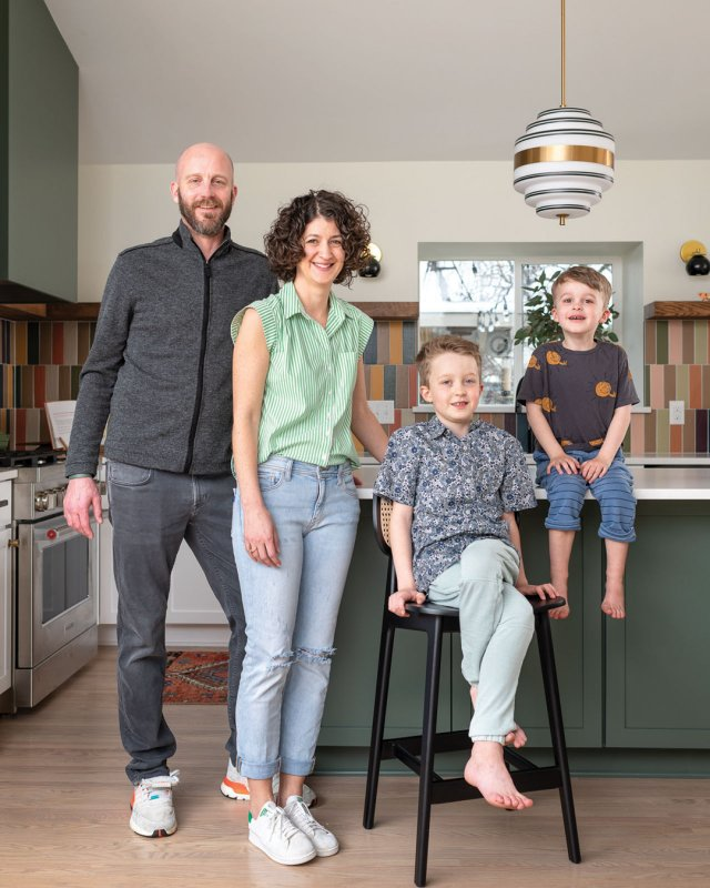 Mom, dad and two sons in kitchen