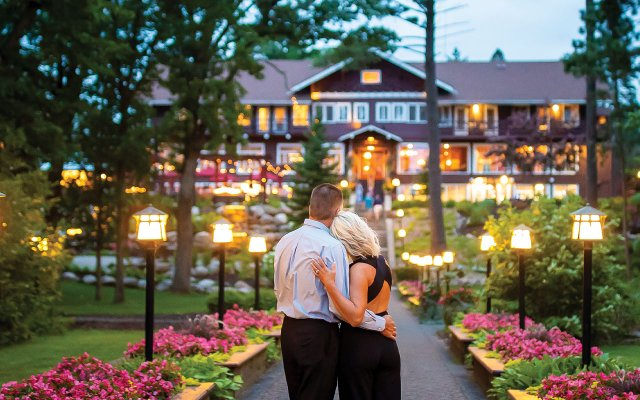 Couple looking at the front of Grand View Lodge