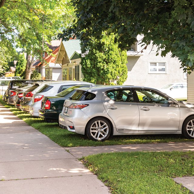 cars parked on front lawns