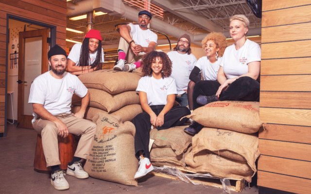 workers on bags of coffee
