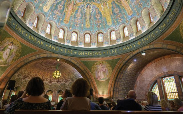 Byzantine-style mosaics cover the interior of the 1910 chapel.