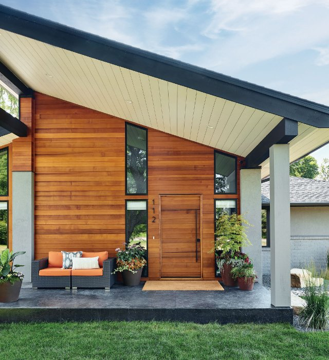 Engineered cedar siding from Weekes Forest  Products in St. Paul creates a smooth transition  from the exterior to the interior