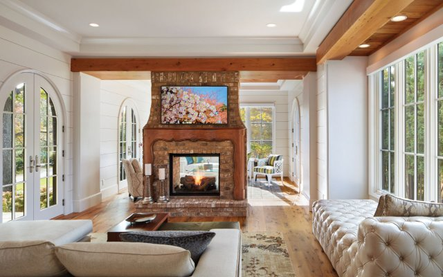 An old mantel salvaged from the site's previous home adds instant character to the fireplace between the library and sunroom