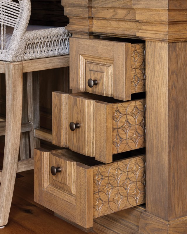 The floral motif seen elsewhere in the house even appears on the sides of drawers in the kitchen island.