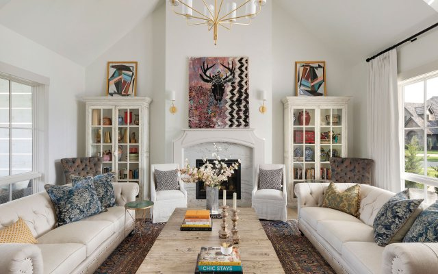 upscale living room with a painting over the fireplace as a focal point