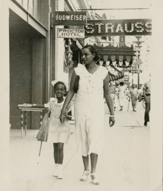 Nettie and Rose Marie Gardner stroll the Rondo neighborhood 30 years before most of it became a highway.