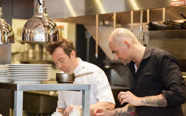 Chefs in Burch kitchen