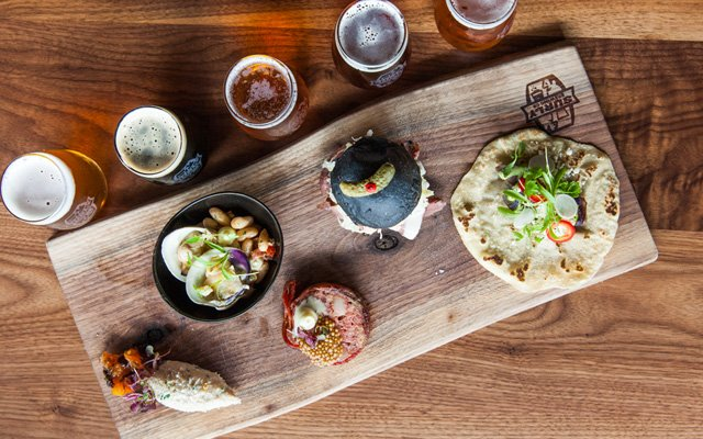 Food and beer samples at Surly Brewing