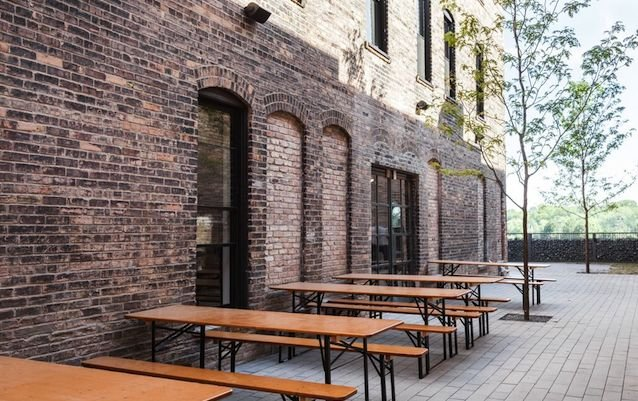 Picnic tables in a North Loop alleyway