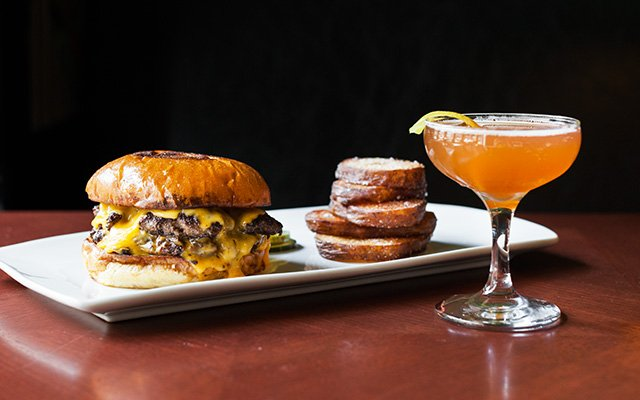 Burger and side with a cocktail at Il Foro