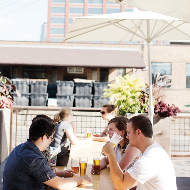 A group of people drinking beer on a patio in the Twin Cities