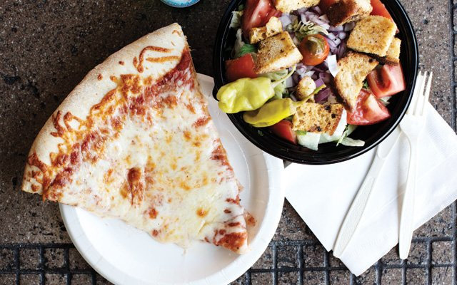 A slice of pizza and salad at Cossetta in St. Paul | photo by Eliesa Johnson